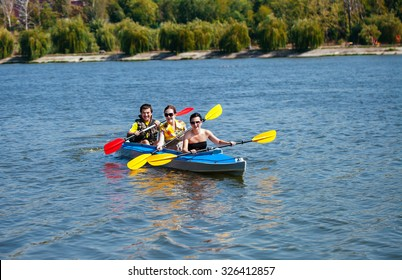 Young people in canoes. Family holiday.