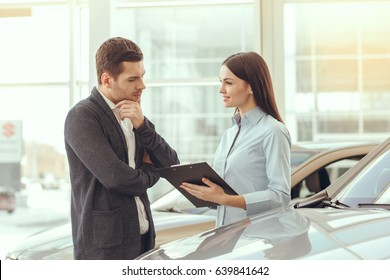 Young People in a Car Rental Service Transportation Concept