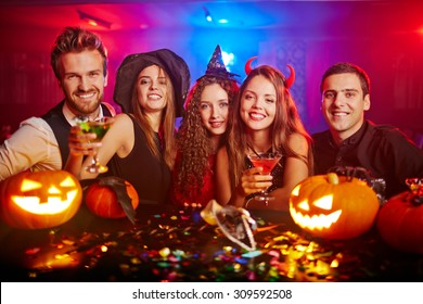 Young people cheering at Halloween