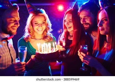 Young people congratulating a girl with her birthday