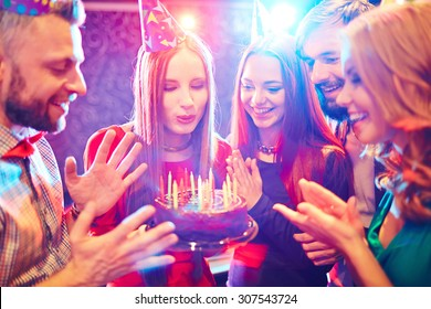 Young people congratulating a woman with birthday