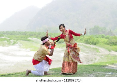 Young People Dacing/ Performing Rongali Bihu  in Traditional Assamese dress outdoor