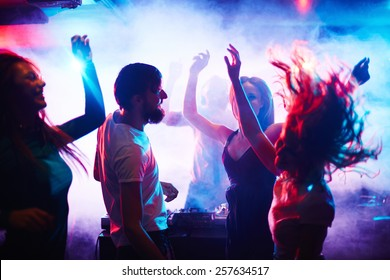 Young people dancing in nightclub