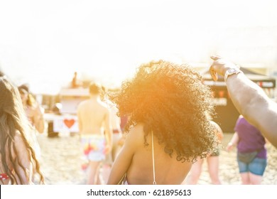 Young people dancing on beach party in summer time - Cheerful multi ethnic having fun outdoor - New music entertainment trends - Focus on black girl afro hair- Unfiltered photo with back flare light