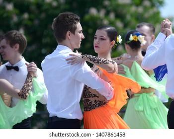 Young people dancing waltz. Costume ball of high-school graduates organized by City Hall of Kiev. May 24, 2019. Kiev, Ukraine