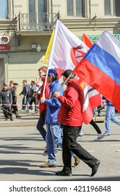 Young people with different flags. St. Petersburg, Russia - 1 May, 2016. Day festive demonstration on the Nevsky Prospect in St. Petersburg, the first of May.