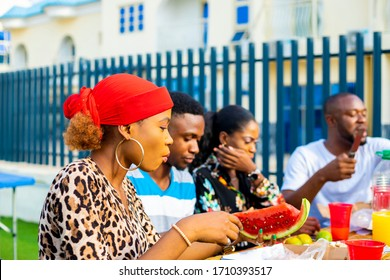 young people dining and having fun drinking red wine together. life style concept