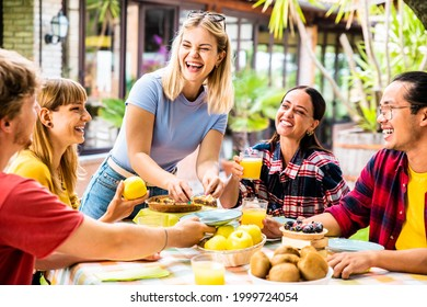 Young people eating healthy food at bio organic restaurant - Happy friends having picnic garden party - Happiness and friendship concept