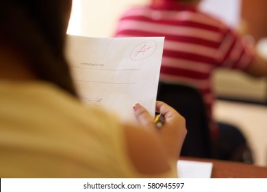 Young people and education. Group of hispanic students in class at school during lesson. Good grade for smart student on test