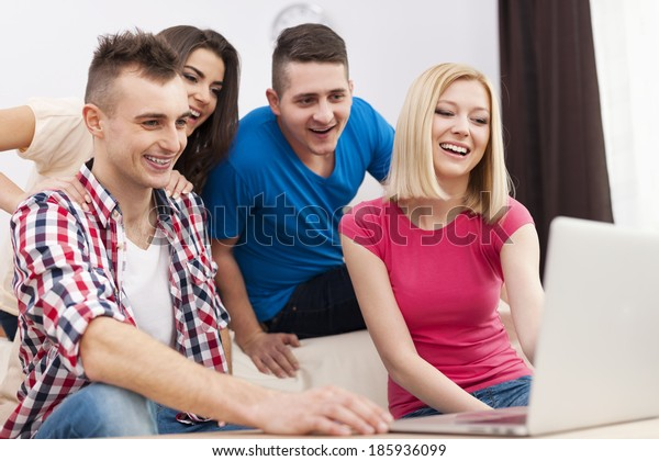 Young people enjoying free net in living room