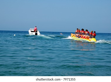 Young people enjoying a ride on a banana boat