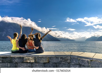 Young people enjoying the sunny day on the fjord, Norway