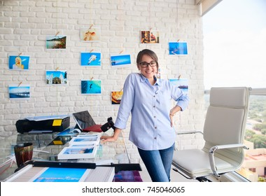 Young people, entrepreneur and small business. Portrait of happy young woman at work as photographer in studio. Confident girl smiling, looking at camera. Artist and art profession.