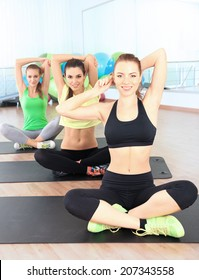 Young people exercising at gym