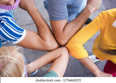 Young people friends bump their elbows instead of greeting with a hug - Avoid the spread of coronavirus, social distance and friendship concept