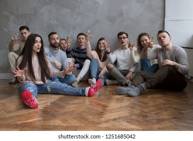 Young People with Glasses of Wine Celebrate. Winter Concept