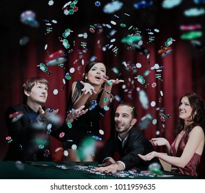 Young people have a good time in casino.