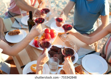 Young people having barbecue party at table