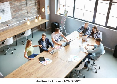 Young people having business meeting in modern office