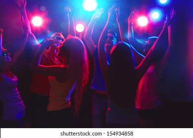 Young people having fun dancing at party.