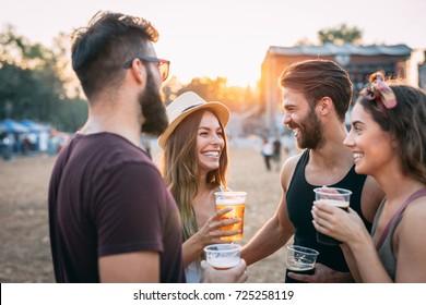Young people having fun at sundown.