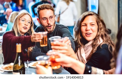 Young people having fun toasting white wine at street food festival - Happy friends eating local plates at restaurant dehor together - Travel and dinning lifestyle concept - High iso on neon filter