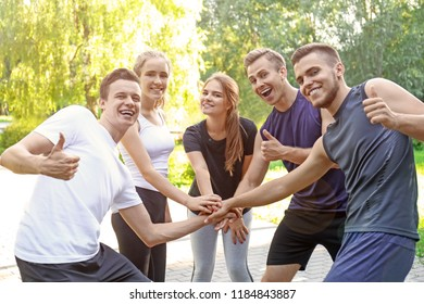 Young people holding hands together