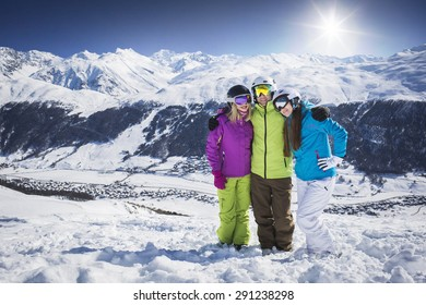 Young people hugging and posing ski resort