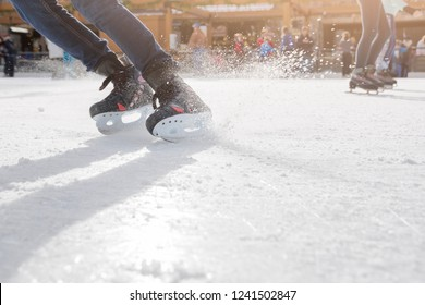 Young people ice skating on ice rink