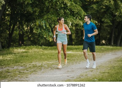 Young people jogging and exercising in nature at sunny day