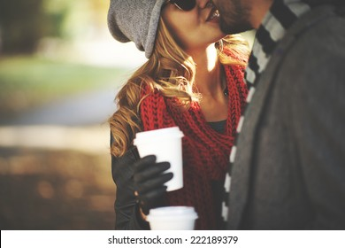 Young people kissing outdoors