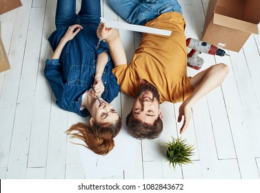 young people lie on the floor, flower in the pot