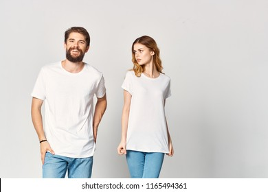 young people in light T-shirts on a gray background