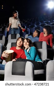 Young people look cinema at a cinema
