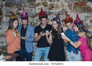 Young people looking down at cellular phone