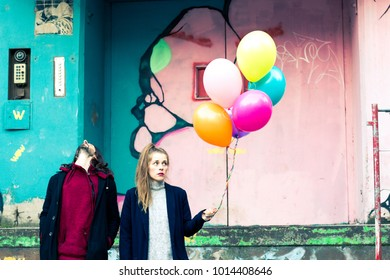 young people in love with colorful balloons outdoors in autumn