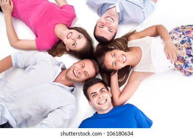 Young people lying down around isolated on white background