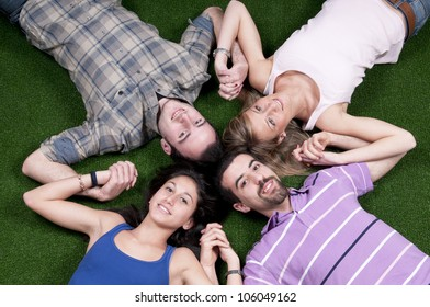 Young people lying down on grass