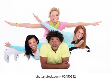Young people lying down on the white background,gesturing fly.