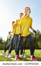 Young people make a game or an exercise for better coordination in the team