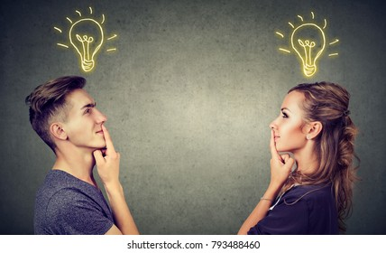 Young people man and woman posing together enlightened with idea looking positive.