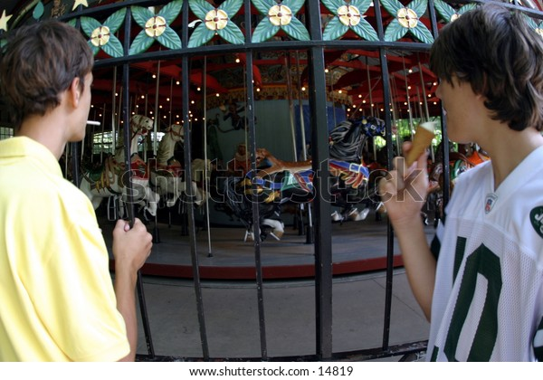 young people at merry-go-round