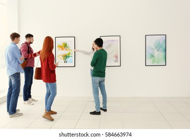 Young people in modern art gallery hall