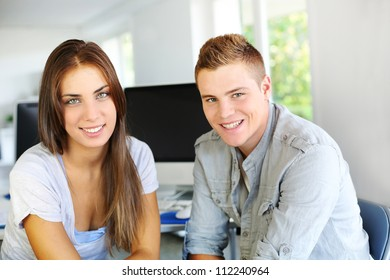 Young people in office working on computer