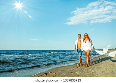 Young people on beach and summer time