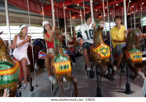 young people on merry-go-round