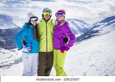 Young people on ski alpine mountain winter resort