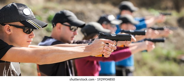 Young people on tactical gun training classes. Shooting and Weapons. Outdoor Shooting Range