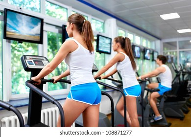 Young people on treadmills