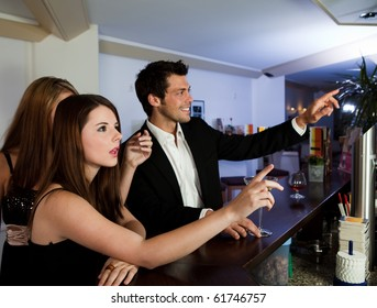 Young people ordering drinks at the bar. Focus on the girl